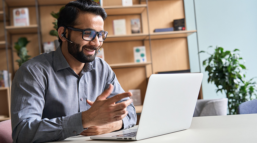 image of man on laptop talking and representing the future of coaching in a digital world