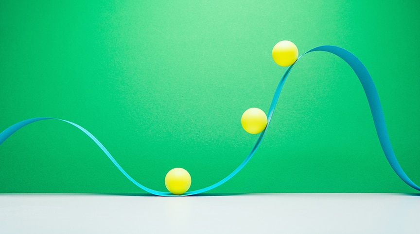 abstract image of ribbon curving around balls representing flexibility in the workplace