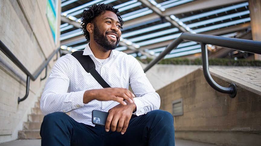 image of employee smiling outside showing how to avoid nonprofit burnout